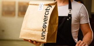 repartidor con bolsa de take away uncovercity