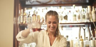 Cheerful Female Bartender Pouring Cocktail In Bar 3771101