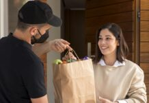 Woman Getting Food Bag Delivered